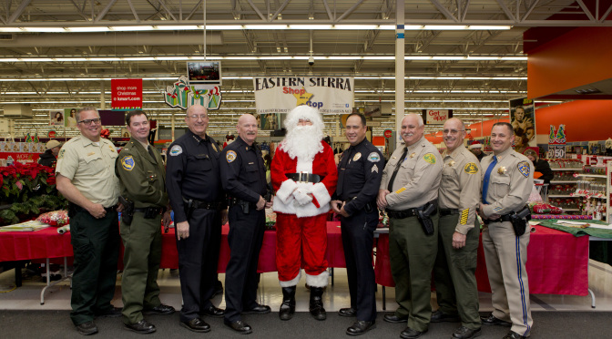 left to right, Captain Rich Watt, US Forest Service; Lieutenant Bill Dailey, California Department of Fish and Wildlife; Chief Dan Watson, Mammoth Lakes Police Department; Chief Chris Carter, Bishop Police Department; Santa Claus; Sergeant Rick Moberly, Mammoth Lakes Police Department; Undersheriff Keith Hardcastle, Inyo County Sheriff's Office; Sheriff Ralph Obenberger, Mono County Sheriff's Office; and Captain Tim Noyes, Bishop CHP